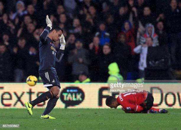 Swansea City goalkeeper Michel Vorm reacts after fouling Cardiff City's Fraizer Campbell for which he was shown a red card