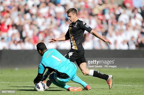 Swansea City goalkeeper Michel Vorm stops Fulham's Alex Kacaniklic