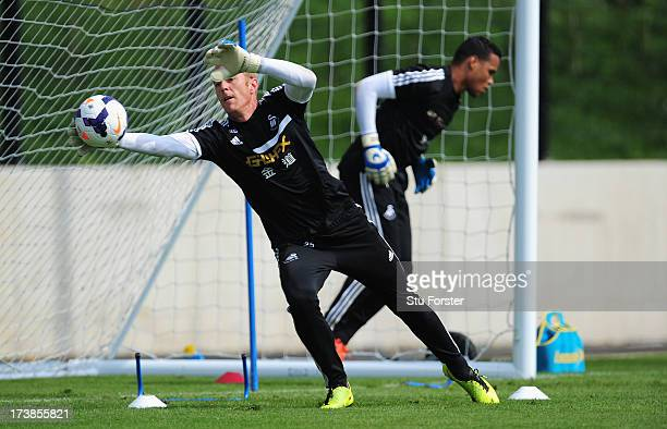 Swansea City goalkepers Gerhard Tremmel and Michel Vorm go through their paces during training at Landore training complex on July 18 2013 in Swansea...