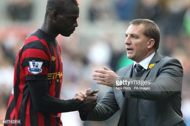 Swansea City manager Brendan Rodgers shakes hands with Manchester City's Mario Balotelli after the final whistle