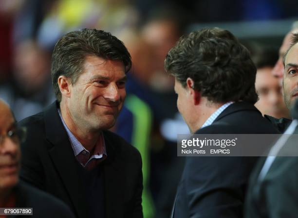 Swansea City manager Michael Laudrup and St Gallen manager Jeff Saibene shake hands before kickoff