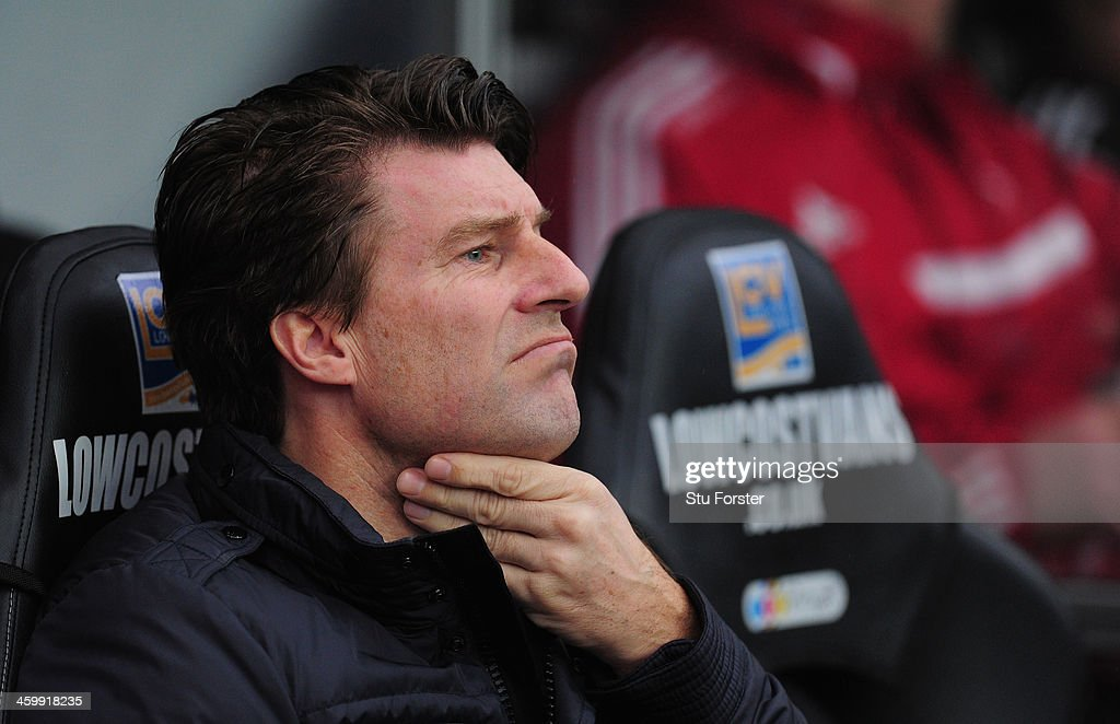 Swansea City manager <a gi-track='captionPersonalityLinkClicked' href=/galleries/search?phrase=Michael+Laudrup&family=editorial&specificpeople=2380115 ng-click='$event.stopPropagation()'>Michael Laudrup</a> looks on before the Barclays Premier League match between Swansea City and Manchester City at Liberty Stadium on January 1, 2014 in Swansea, Wales.