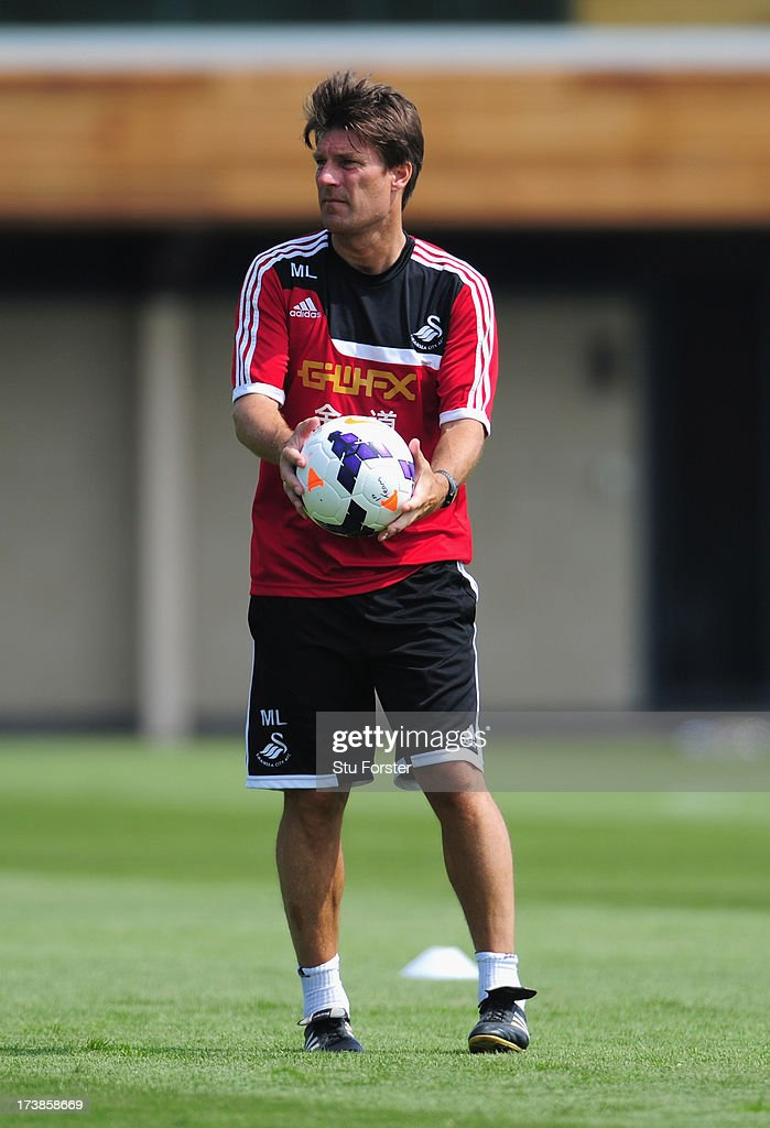 Swansea City manager Michael Laudrup looks on during training at Landore training complex on July 18, 2013 in Swansea, Wales.