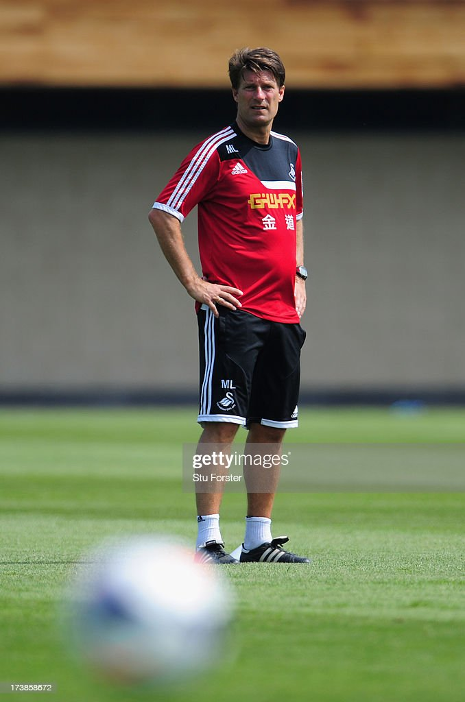Swansea City manager <a gi-track='captionPersonalityLinkClicked' href=/galleries/search?phrase=Michael+Laudrup&family=editorial&specificpeople=2380115 ng-click='$event.stopPropagation()'>Michael Laudrup</a> looks on during training at Landore training complex on July 18, 2013 in Swansea, Wales.