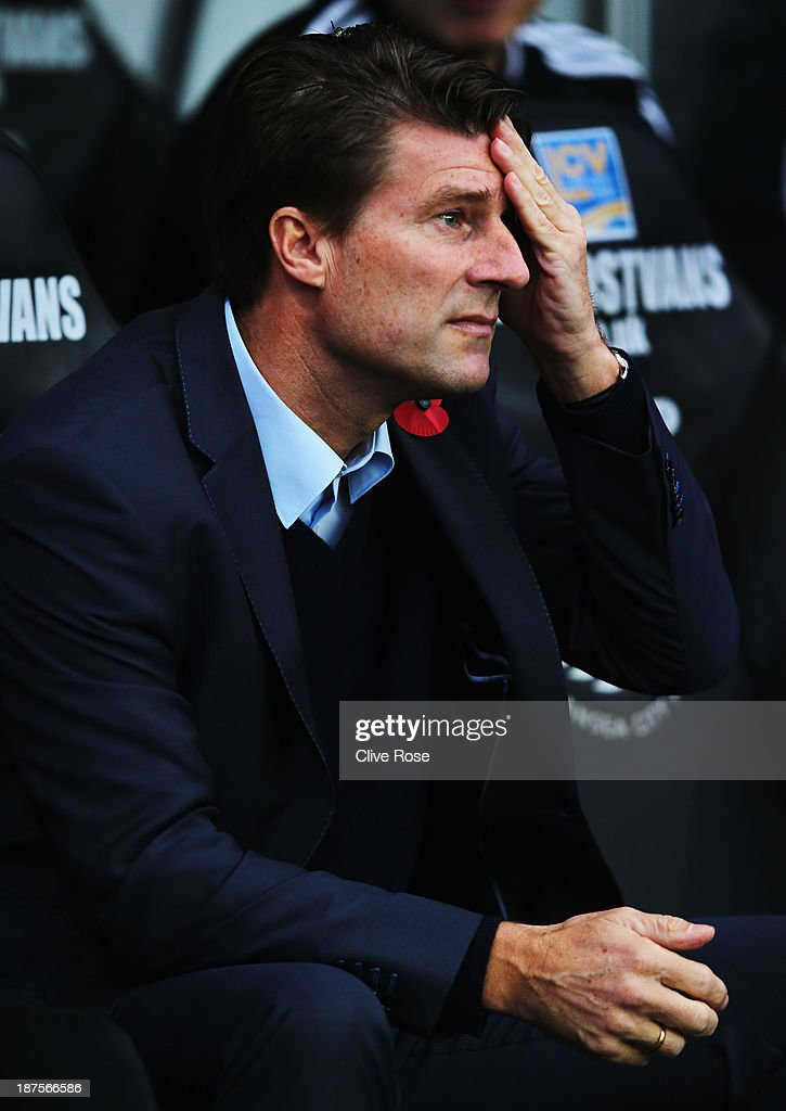 Swansea City manager <a gi-track='captionPersonalityLinkClicked' href=/galleries/search?phrase=Michael+Laudrup&family=editorial&specificpeople=2380115 ng-click='$event.stopPropagation()'>Michael Laudrup</a> looks on from the touchline before the Barclays Premier League match between Swansea City and Stoke City at Liberty Stadium on November 10, 2013 in Swansea, Wales.