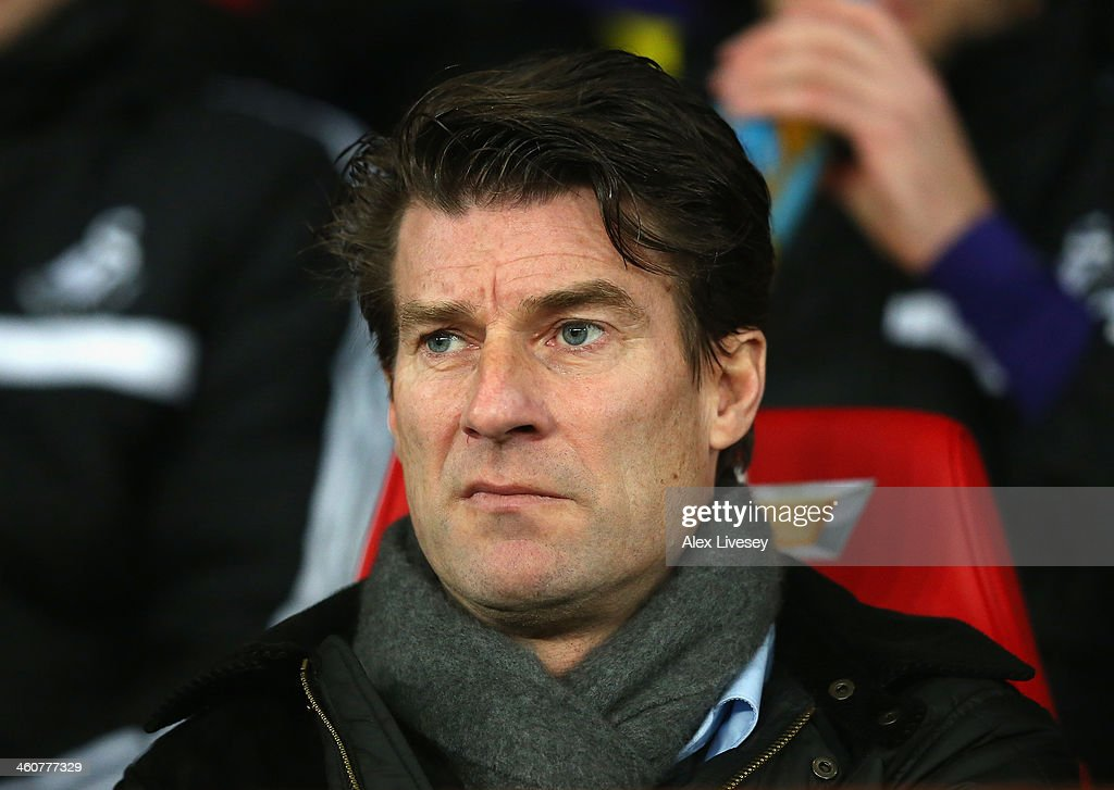 Swansea City Manager <a gi-track='captionPersonalityLinkClicked' href=/galleries/search?phrase=Michael+Laudrup&family=editorial&specificpeople=2380115 ng-click='$event.stopPropagation()'>Michael Laudrup</a> looks on prior to the FA Cup with Budweiser Third round match between Manchester United and Swansea City at Old Trafford on January 5, 2014 in Manchester, England.