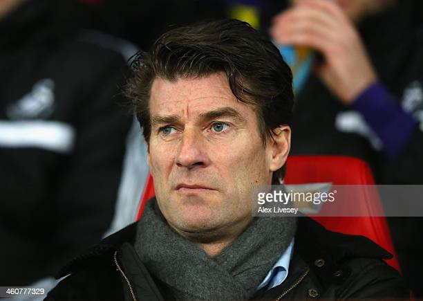 Swansea City Manager Michael Laudrup looks on prior to the FA Cup with Budweiser Third round match between Manchester United and Swansea City at Old...