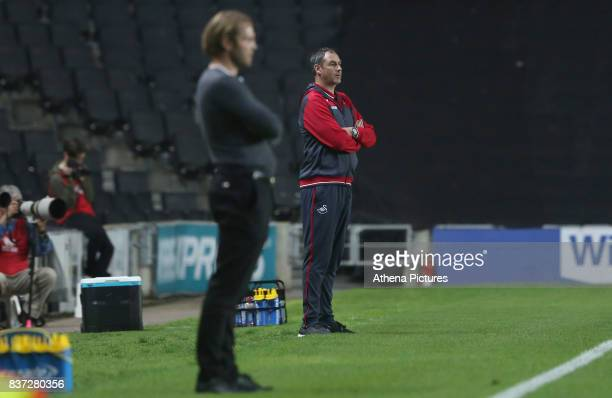 Swansea City manager Paul Clement and MK Dons manager Robbie Nelson during during the Carabao Cup Second Round match between MK Dons and Swansea City...