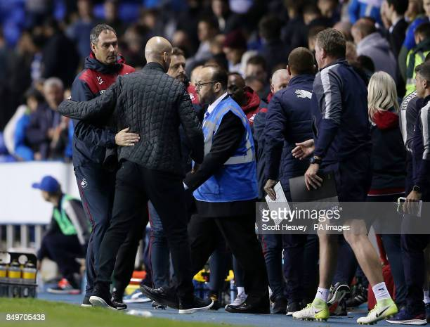 Swansea City manager Paul Clement and Reading manager Jaap Stam after the final whistle of the Carabao Cup third round match at the Madejski Stadium...