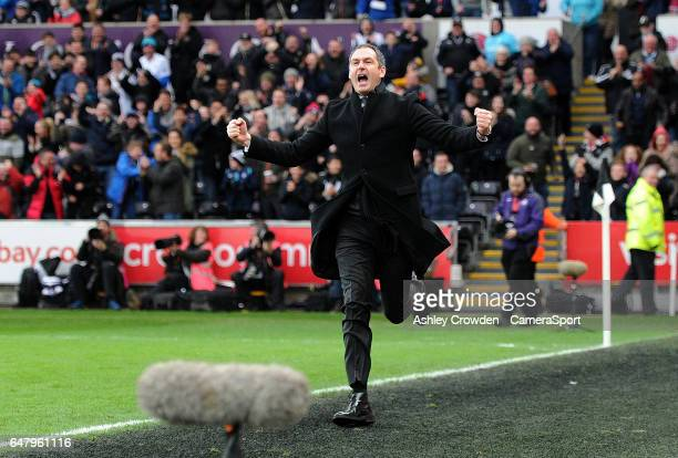 Swansea City manager Paul Clement celebrates after Swansea City's Fernando Llorente scores the winning goal during the Premier League match between...