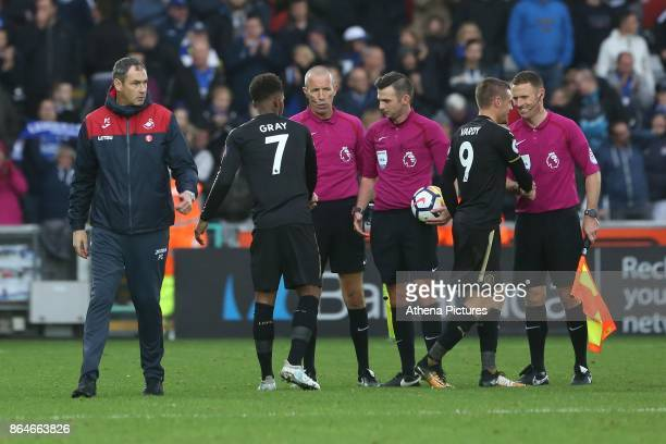 Swansea City manager Paul Clement walks away after shaking the hands of the match officials after the final whistle of the Premier League match...