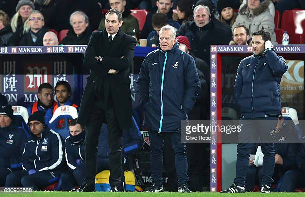Swansea City new manager Paul Clement stands next to caretaker manager Alan Curtis during the Premier League match between Crystal Palace and Swansea...