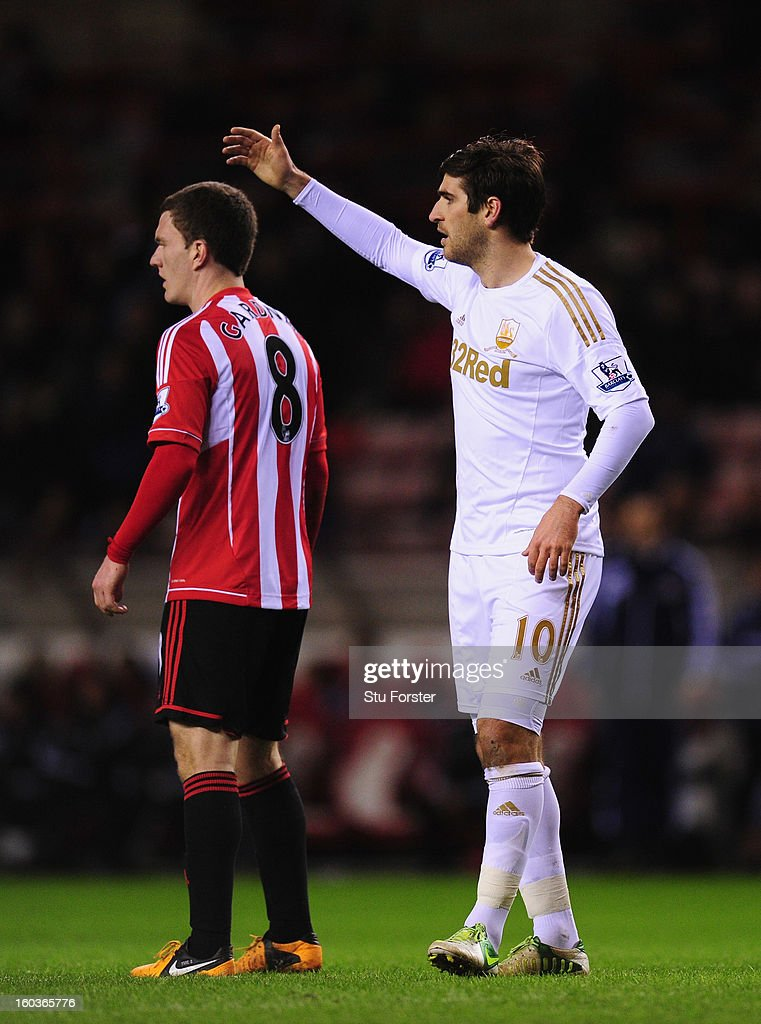 Swansea City player Danny Graham (r) gestures during the Barclays Premier League match between Sunderland and Swansea City at Stadium of Light on January 29, 2013 in Sunderland, England.