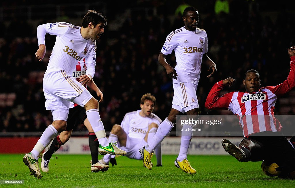 Swansea City player Danny Graham (l) is denied a goal by Titus Bramble (r) in the last minute of the game during the Barclays Premier League match between Sunderland and Swansea City at Stadium of Light on January 29, 2013 in Sunderland, England.