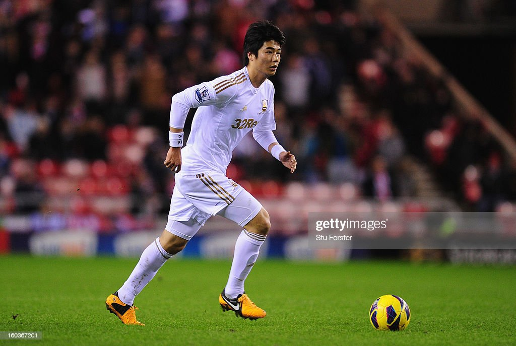 Swansea City player Ki Sung-Yeung in action during the Barclays Premier League match between Sunderland and Swansea City at Stadium of Light on January 29, 2013 in Sunderland, England.