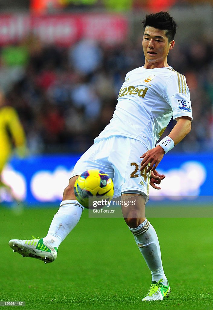 Swansea City player Ki Sung-Yueng in action during the Barclays Premier League match between Swansea City and Liverpool at Liberty Stadium on November 25, 2012 in Swansea, Wales.