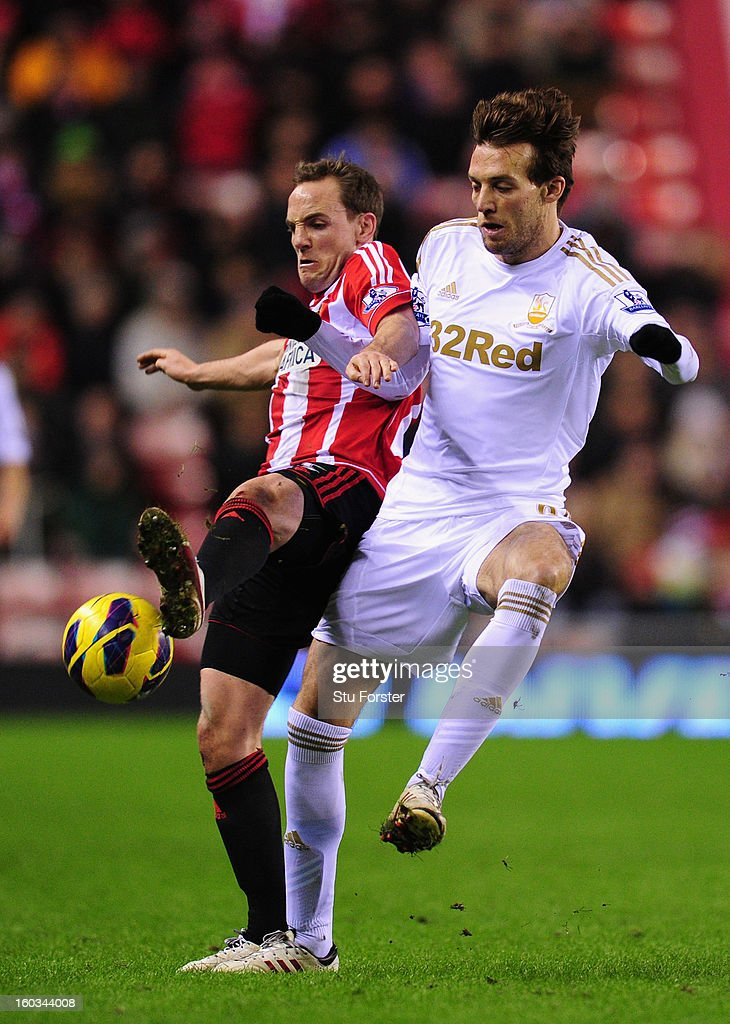 Swansea City player Michu (r) is challenged by Sunderland player David Vaughan during the Barclays Premier League match between Sunderland and Swansea City at Stadium of Light on January 29, 2013 in Sunderland, England.