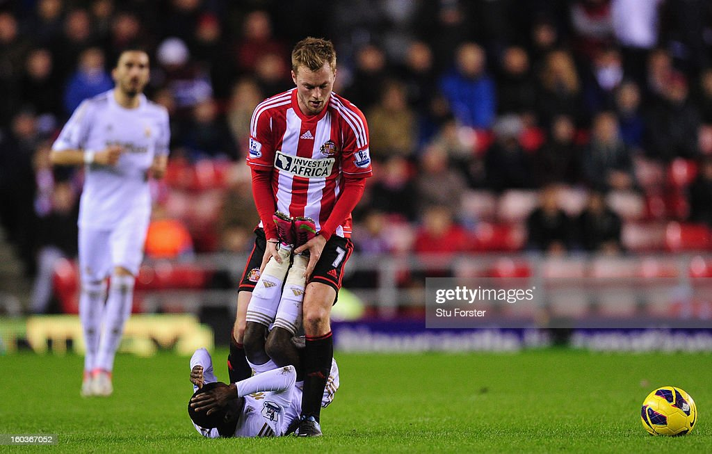 Swansea City player Nathan Dyer and Sunderland player <a gi-track='captionPersonalityLinkClicked' href=/galleries/search?phrase=Sebastian+Larsson&family=editorial&specificpeople=719331 ng-click='$event.stopPropagation()'>Sebastian Larsson</a> in action during the Barclays Premier League match between Sunderland and Swansea City at Stadium of Light on January 29, 2013 in Sunderland, England.