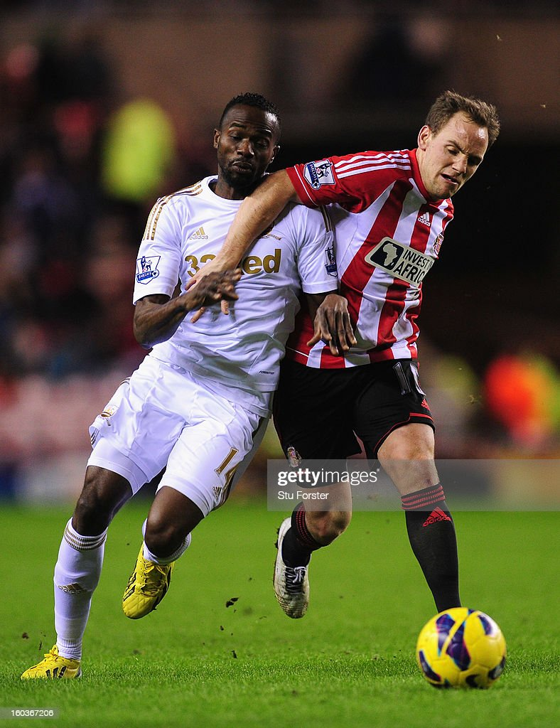 Swansea City player Roland Lamah (l) challenges Sunderland player David Vaughan during the Barclays Premier League match between Sunderland and Swansea City at Stadium of Light on January 29, 2013 in Sunderland, England.