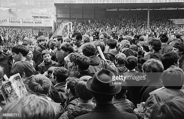 Swansea City players being bombarded by fans following their win in a testimonial football match with Leeds United 26th May 1968