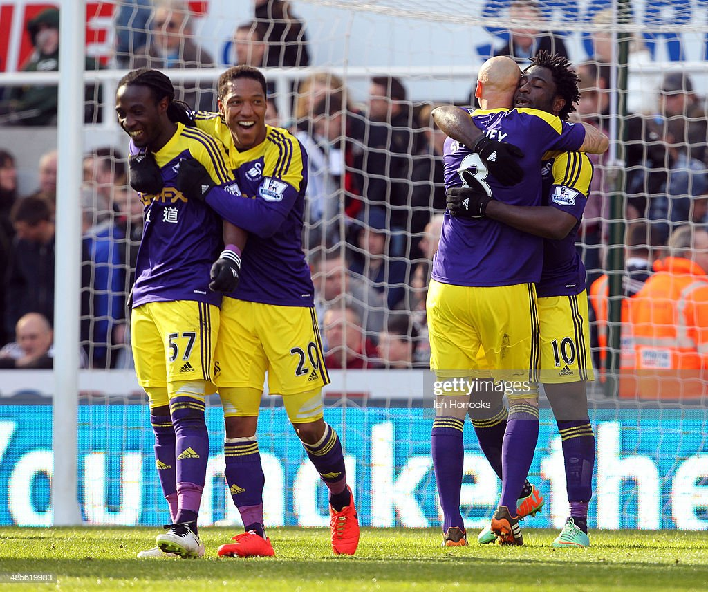 Swansea City players (L-R) Kyle Bartley, Jonathan De Guzman, Jonjo Shelvey and goalscorer Wilfried Bony celebrate after the winning goal during the Barclays Premier League match between Newcastle United and Swansea City at St James' Park on April 19, 2014 in Newcastle upon Tyne, England.