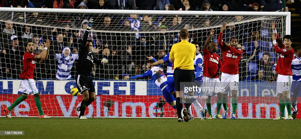 Swansea City players react to the disallowed goal of Adam Le Fondre of Reading as he hands the balll during the Barclays Premier League match between Reading and Swansea City at Madejski Stadium on December 26, 2012 in Reading, England.