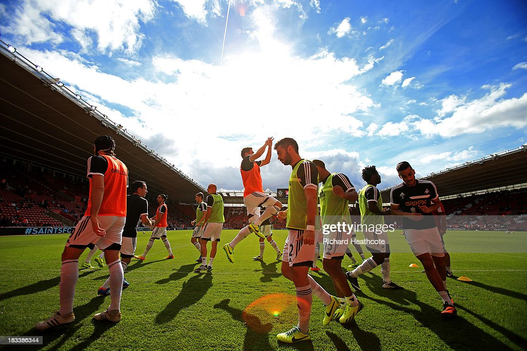 Swansea City players warm up prior to the Barclays Premier League match between Southampton and Swansea City at St Mary's Stadium on October 6, 2013 in Southampton, England.
