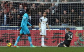 Swansea City' Spanish defender Chico Flores stands dejected after scoring an own goal during the English Premier League football match between...