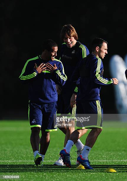 Swansea City striker Michu shares a joke with Wayne Routledge during Swansea City training ahead of their Europa League match against Kuban tomorrow...