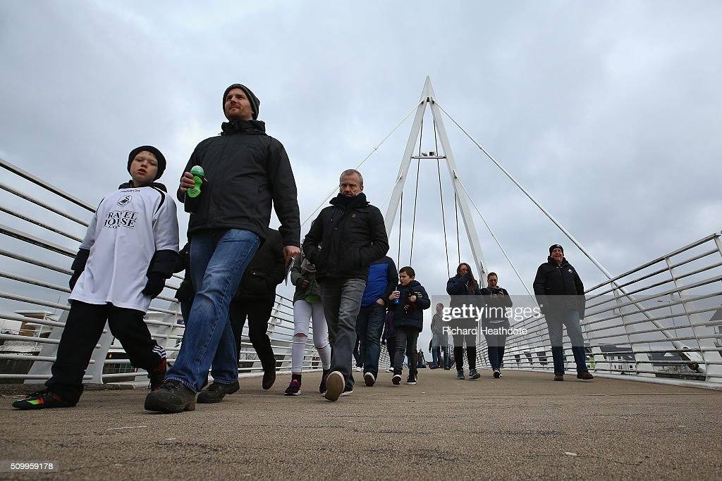 Swansea City supporters make their way to the stadium prior to the Barclays Premier League match between Swansea City and Southampton at Liberty Stadium on February 13, 2016 in Swansea, Wales.
