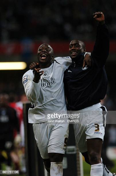 Swansea City's Adebayo Akinfenwa and Kevin Austin celebrate at the end of the game