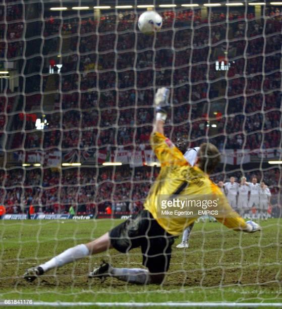 Swansea City's Adebayo Akinfenwa blazes the ball over the cross bar to miss a penalty