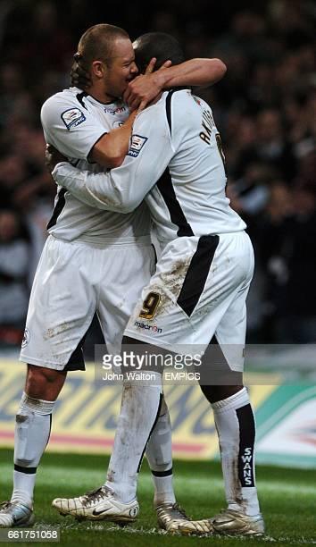 Swansea City's Adebayo Akinfenwa celebrates scoring the second goal with Lee Trundle
