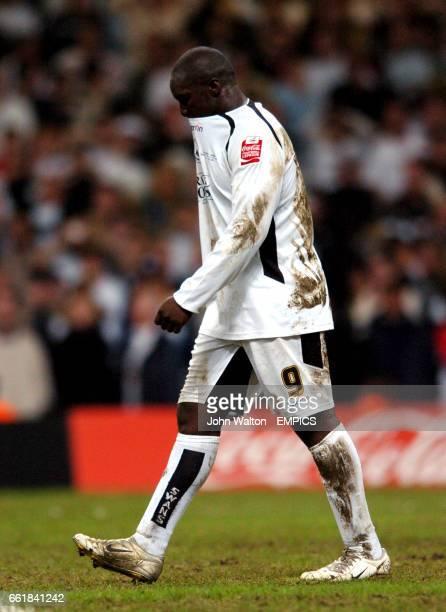 Swansea City's Adebayo Akinfenwa is dejected after missing his penalty