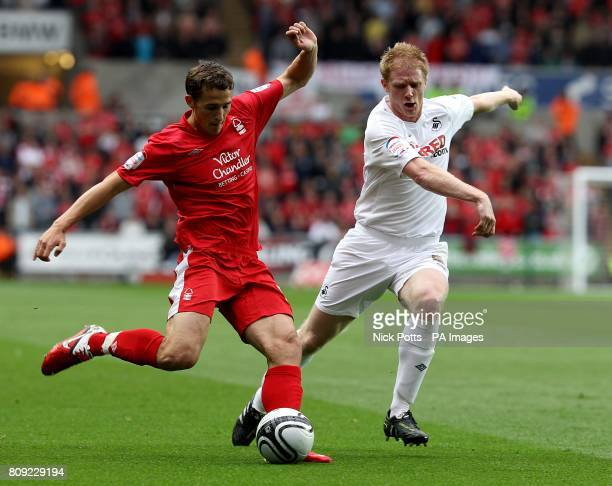 Swansea City's Alan Tate and Nottingham Forest's Chris Cohen battle for the ball