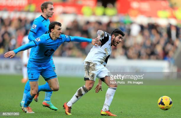 Swansea City's Alejandro Pozuelo and Tottenham Hotspur's Vlad Chiriches battle for the ball