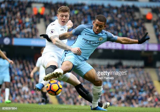 Swansea City's Alfie Mawson and Manchester City's Gabriel Jesus battle for the ball