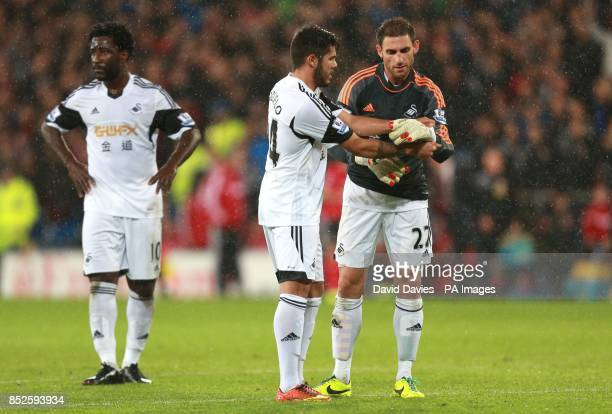 Swansea City's Angel Rangel takes over in goal after Michel Vorm is sent off during the Barclays Premier League match at Cardiff City Stadium Cardiff