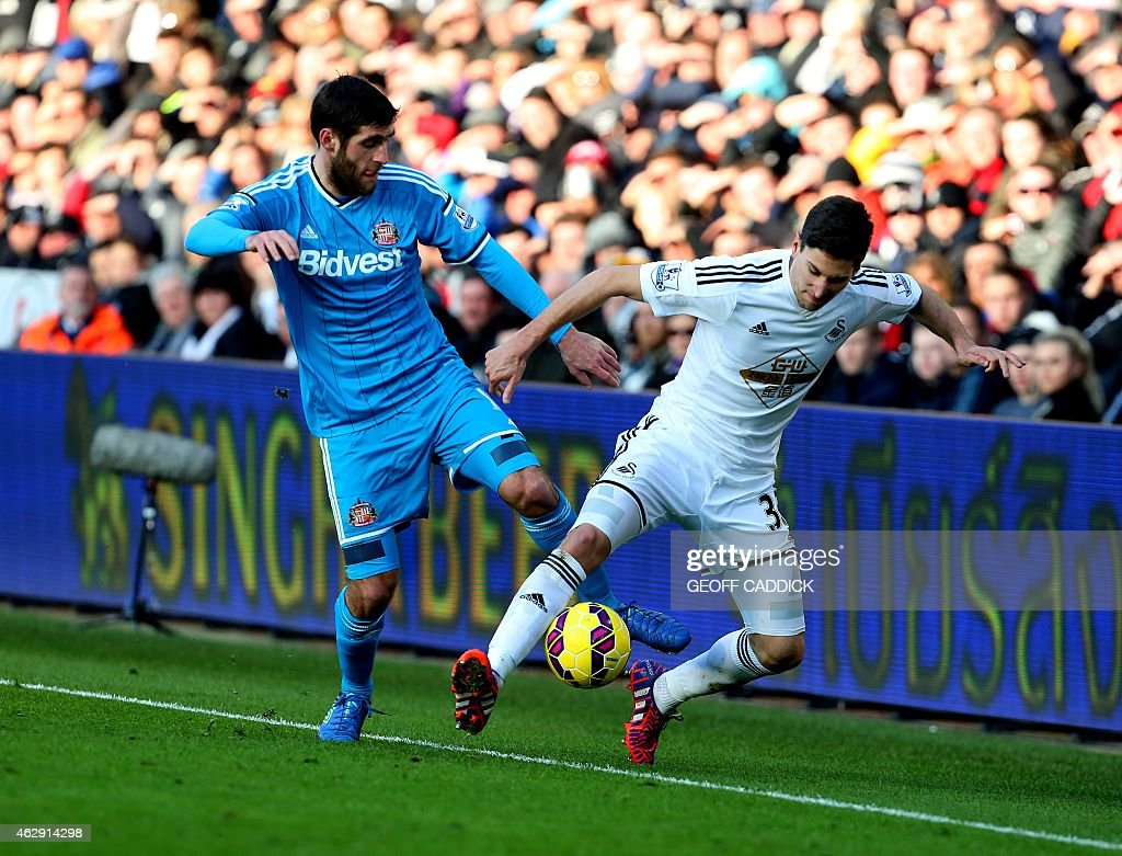 Swansea City's Argentinian defender Federico Fernandez (R) and Sunderland's English striker <a gi-track='captionPersonalityLinkClicked' href=/galleries/search?phrase=Danny+Graham+-+Fotbollsspelare&family=editorial&specificpeople=11679831 ng-click='$event.stopPropagation()'>Danny Graham</a> (L) vie for the ball during the English Premier League football match between Swansea City and Sunderland at The Liberty Stadium in Swansea, south Wales on February 7, 2015. AFP PHOTO / GEOFF CADDICK USE. No use with unauthorized audio, video, data, fixture lists, club/league logos or live services. Online in-match use limited to 45 images, no video emulation. No use in betting, games or single club/league/player publications.