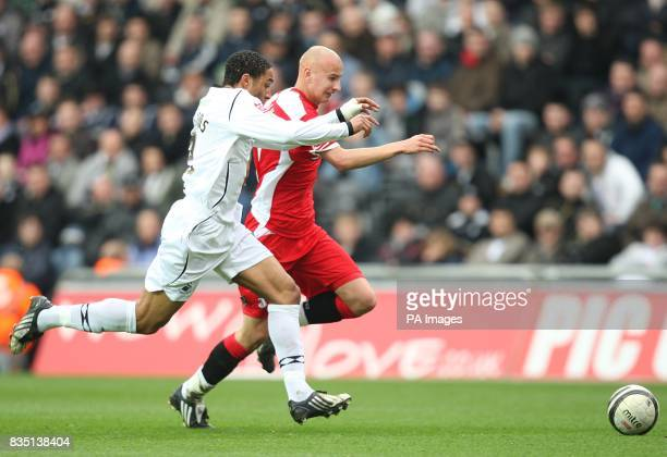 Swansea City's Ashley Williams and Charlton Athletic's Jonjo Shelvey in action
