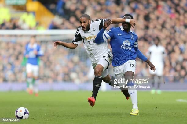Swansea City's Ashley Williams and Everton's Romelu Lukaku battle for the ball