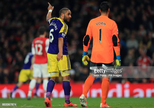 Swansea City's Ashley Williams talks with Swansea City goalkeeper Michel Vorm during the Barclays Premier League match at the Emirates Stadium London