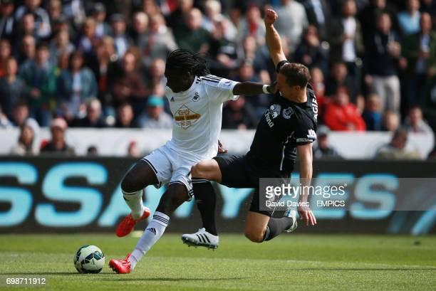 Swansea City's Bafetimbi Gomis and Everton's Phil Jagielka