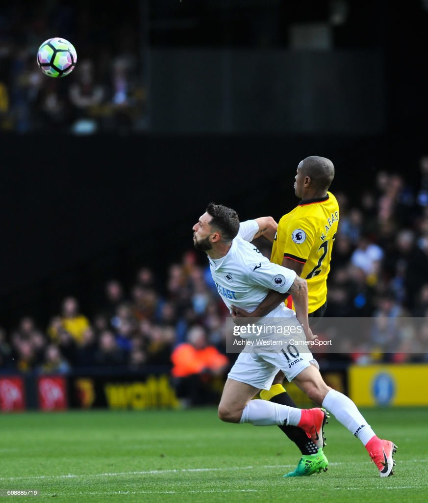 Swansea City's Borja Gonzalez battles for possession with Watford's Christian Kabasele during the Premier League match between Watford and Swansea City at Vicarage Road on April 15, 2017 in Watford, England.