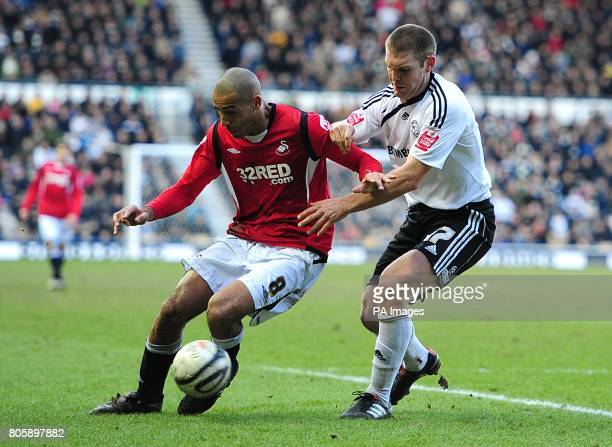 Swansea City's Darren Pratley and Derby County's Jake Buxton in action