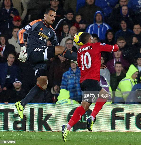 Swansea City's Dutch goalkeeper Michel Vorm challenges Cardiff City's English striker Fraizer Campbell outside the box and is sent off by referee...