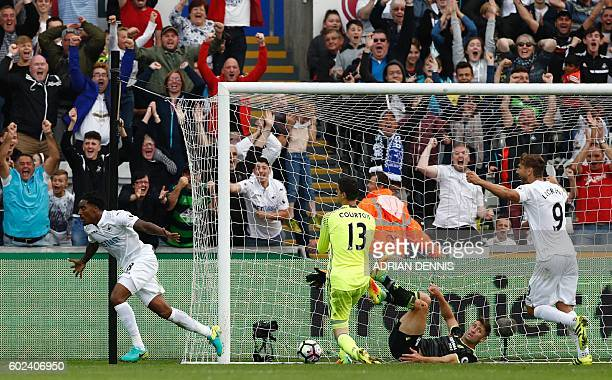 Swansea City's Dutch midfielder Leroy Fer celebrates after scoring their second goal as Chelsea's Belgian goalkeeper Thibaut Courtois and Chelsea's...