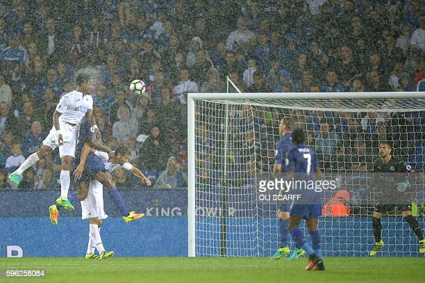 TOPSHOT Swansea City's Dutch midfielder Leroy Fer scores from a header during the English Premier League football match between Leicester City and...