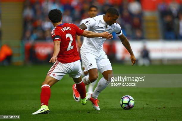 Swansea City's Dutch midfielder Luciano Narsingh vies with Middlesbrough's Brazilian defender Fabio during the English Premier League football match...