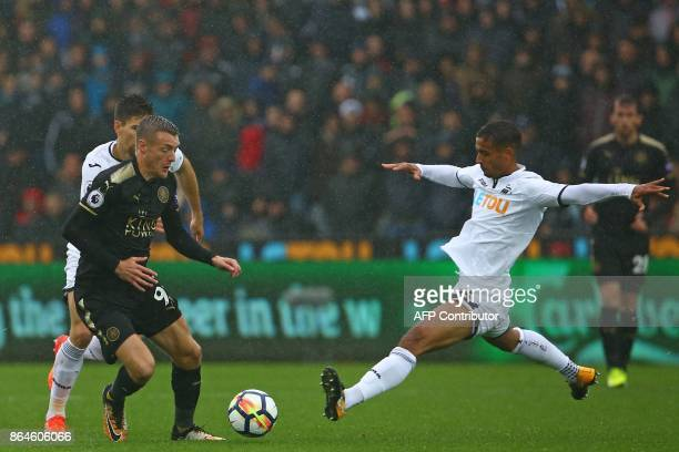 Swansea City's English defender Kyle Naughton slides in to make a tackle on Leicester City's English striker Jamie Vardy during the English Premier...